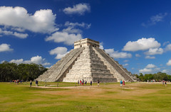El Castillo with clouds (Adaptabilly) Tags: grass shadow building triangle people mx chichenitza clouds religion ruins travel mayan tree sky architecture mexico yucatán sculpture archaeology stairs lumixgx7 kukulkan