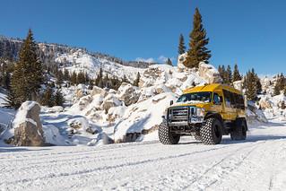Snowcoach riding through the Hoodoos