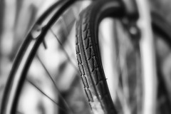 Broken tire. (Dikke Biggie.) Tags: 52in2018 4transport transport bike bicycle fiets bicycletire tire fietsband band closeup detail macro canon canoneos450d 50mm f14 blackandwhite bw black white zwartwit zw zwart wit monochrome monochroom dof depthoffield scherptediepte bokeh dgawc canonnl