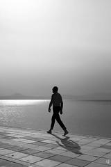 Keep walking (tzevang.com) Tags: walking bythesea bw greece sea seascape man loutraki fujifilm x100f