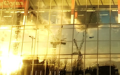 pioneer point, cranes reflected in the glass, in the winter sunset, ilford ig1, 2018-03-15, 17-35-28 (tributory) Tags: london eastlondon ilford towncentre redevelopment pioneerpoint glass yellow winter cranes ig1 urban modernist tower towerblock gym reflections sunlight building architecture spring weather seasons