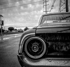 Gloomy Galaxy (El Cheech) Tags: wet raining lonely street bumper rearend taillight carport carpis car photography blackandwhitephotography blackandwhite edison powerlines cloudy clouds lowlow gangster greaser hotrod sleepingcar classical rain gloomy lowrider ford galaxie500 galaxie galaxy