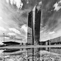 The Money Machine (Leipzig_trifft_Wien) Tags: architecture modern contemporary urban city scyscarper steel glass puddle reflection sky high grey black white monochrome