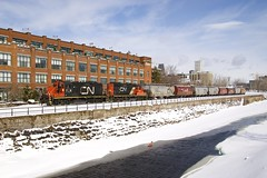 Along the partially frozen canal (Michael Berry Railfan) Tags: cn canadiannational eastsidecanalbank train freighttrain montreal sthenri quebec cn7226 cn7075 emd gmd lachinecanal winter snow ice