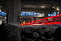 Light Speed on Lakeshore (Paul Flynn (Toronto)) Tags: toronto lakeshore tunnel bridge avenue road street long exposure light stream brake rocks stones concrete downtown gardiner express way streak