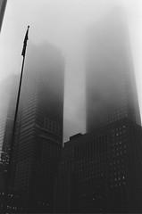 Foggy Winter (Kevo89) Tags: film jch400 japancamerahunter streetpan400 bw blackwhite 35mm minolta toronto building urban fog foggy financialdistrict