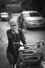 Gas Delivery Girl (fredMin) Tags: black white street portrait girl monochrome asia thailand bangkok gas bottle travel fujifilm xt1 56mm