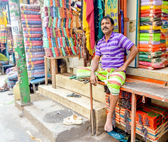 Sitter (Francisco Anzola) Tags: chennai market india man seller vendor shopkeeper store