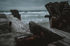 Weathered/3 (trevormarron) Tags: dark worn desolate abandoned tattered rust nature ocean waves gloom haze fog overcast iron structure