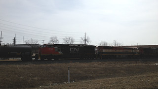 CN 2706, BC Rail 4802, and CN 2162 pull a freight train south near Kampo Rd in Neenah.
