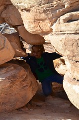 Everett Squeezing Through An Arch On The Slickrock Trail (Joe Shlabotnik) Tags: nationalpark utah hiking 2017 justeverett canyonlands everett november2017 canyonlandsnationalpark afsdxvrzoomnikkor18105mmf3556ged