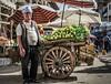 Lettuce seller (Nadia Rifaat) Tags: street photography lettuce vendor market outdoor vegetables man alexandria egypt people nikon d5300
