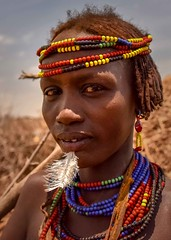 Dassanech Woman (Rod Waddington) Tags: africa african afrique afrika äthiopien ethiopia ethiopian ethnic etiopia ethnicity ethiopie etiopian omovalley omo outdoor omoriver omerate dassanech tribe traditional tribal woman feather beads huts village portrait people