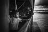 Sailing towards home (Feca Luca) Tags: street reportage portrait ritratto children bimbi blackwhite people passenger passeggero boat travel nikon peru southamerica