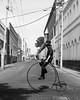 Guy riding a high wheeler (Frederik Trovatten) Tags: bnw blackandwhite bike biking old school oldschool penny farthing