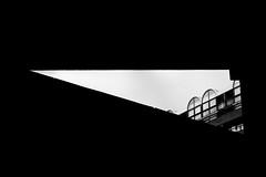 Polygon Window 2 (That James) Tags: polygon window polygonwindow barbican london england uk britain greatbritain urban capital development building framed blackandwhite abstract minimal triangle shape architect architectural concrete city central 1970s 1980s arch beams minimum design public infrastructure estate buildings