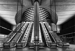 Canary Wharf Underground, England (AdelheidS Photography) Tags: monochrome lines architecture geometric staircase symmetry underground subway london canarywharf jubileeline adelheidsmitt adelheidsphotography blackandwhite modern adeheidspictures city escalator building england unitedkingdom greatbritain tube