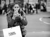 Touch Screen (Stuart Mac) Tags: candid mono woman street isolation shopper shopping fur winter phone distraction face fuji xt2 f12