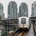 TransLink's Bombardier Innovia ART 200 Coming Through the Vancouver Rain