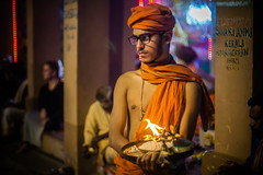 thoughtful pause (andy_8357) Tags: sony a6000 india street portrait portraiture candid young brahmin male man glasses spectacles prasad ilcenex 6000 mirrorless aarti puja fire flame quiet stillness ilce6000 canon fd 50mm f14 vintage low light orange turban thoughtful pause hindu hinduism religion ceremony religious varanasi ghat ghats ganga mother photography e emount