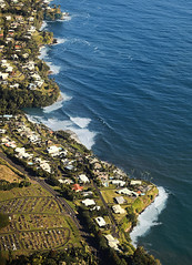 Scalloped Shoreline (wyojones) Tags: hawaii hilobay hilo shoreline coast shore homes road cemetary ocean sea sand water waves pacificocean trees suburbs blue seacliffs