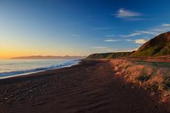 Golden Hour at Palliser Bay (Jos Buurmans) Tags: bay beach capepalliser coastallandscape coastline evening goldenhour landscape nature newzealand northisland palliserbay sand seascape southwairarapa wairarapa wellington nz