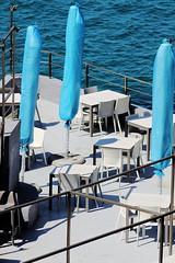 Trois bleus (ZUHMHA) Tags: marseille france water sea barrière gardefou fence chaise chair table parasol bleu blue color couleur terrasse line lignes courbes curve geometry géométrie