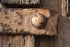 Door Detail (lorinleecary) Tags: californiacentralcoast cambria macro iron strap jail gaol grain lines