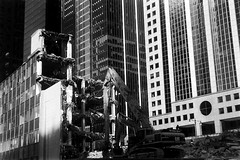 Chicago Demolition (bac1967) Tags: beerenol beerol beer pabstblueribbonbeer caffenol ilforddelta100 ilford delta 35mmfilm 35mm 135film blackandwhite blackandwhitefilm blackwhite black white monochrome monotone pan panfilm chicago chicagoil illinois midwest downtown city filmphotography film leica leicaiif rangefinder rangefindercamera leicarangefinder elmarlens elmar elmarltmlens leitzelmar5cmf35lens uncoatedlens barnack skyline chicagoskyline chicagoriver demolition urbanrenewal excavator construction catexcavator heneghan