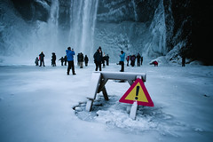 Skógafoss (BurlapZack) Tags: southernregion iceland is skógafoss pentaxk1 pentaxfa20mmf28 vscofilm pack02 waterfll waterfall caution danger achtung ice slippery frozen pothole tourists vacation travel winter snow cold freeze slip wideangle dark tourism sightseeing visitors skogar rangarvallasysla selfies selfie