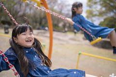 Little sisters playing on swing together (Apricot Cafe) Tags: img86424 asia asianandindianethnicities healthylifestyle japan japaneseethnicity tamronsp35mmf18divcusdmodelf012 backlight candid carefree casualclothing charming cheerful chibaprefecture child childhood colorimage day elementarystudent enjoyment girls happiness leisureactivity lifestyles longhair nature outdoorplayequipment outdoors people photography playing preschoolage publicpark satisfaction schoolchildren sideview smiling springtime straighthair sunlight sustainablelifestyle swing toddler togetherness toothysmile twopeople waistup weekendactivities ichiharashi chibaken jp