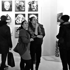 At the Exposition (Akbar Simonse) Tags: amsterdam mokum 010 holland netherlands nederland gogallery streetphotography straatfotografie inside zwartwit bw blancoynegro bn monochrome vierkant square people women girls candid strasenfotografie