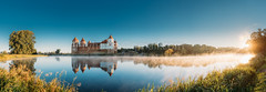 Mir, Belarus. Panoramic Scenic View Of Castle Complex Mir On Sunny Sunrise Sky Background. Panorama Of Morning Fog Over Lake River And Old Towers Are Reflected In Water (Ryhor Bruyeu) Tags: mircastle ancient architecture belarus building castle complex copyspace dawn ensemble europe famous fog fortress heritage historical lake landmark landscape light medieval mir mist monument morning museum old outdoor panorama park reflection river scene scenic sight sightseeing site sky summer sun sunny sunray sunrise sunset tourism tower town travel unesco hrodnaregion by