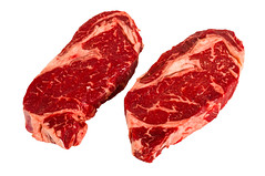 Ribeye steaks isolated on white background (meer43) Tags: red steak veal rib two couple perspective juicy prepare marinade fry roast grill culture american cuisine kitchen isolated white