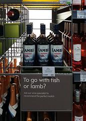 fish or lamb? (amazingstoker) Tags: pink prosecco shelf sign lamb fish basingstoke amazingstoke basingrad waitrose super market back lit rum wine white red spirit rack navy