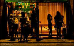 Silhouettes (Fermat 48) Tags: dirtymartini cocktailbar manchester peterstreet silhouette orange glow fridaynight hardylasses canon eos 7dmarkii night dark cold