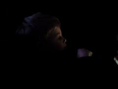 P3012906-2 (NorthernJoe) Tags: boy portrait child tablet shadow highlight low key relax son black dark night evening screen profile candid olympus