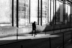 Along old stones (pascalcolin1) Tags: paris homme man mur wall pierres stones soleil sun ombres shadows lumière light photoderue streetview urbanarte noiretblanc blackandwhite photopascalcolin 50mm canon50mm canon