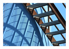 blue curves (mcfcrandall) Tags: patterns pattern lines straight curve shadows light blue sky repeating abstract