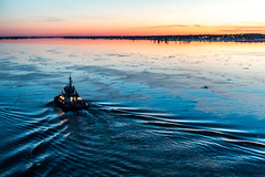 A mighty boat (langdon10) Tags: canada canon70d clearskies quebec shoreline stlawrenceriver sunset tugboat calm nautical outdoors reflections