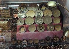 Damascene ware, Toledo (Anita363) Tags: damascening damascene metalwork metal gold silver steel pattern inlay jewish mogendavid magendavid starofdavid menorah shop store display window toledo castilelamancha spain españa