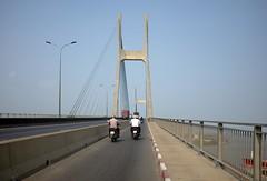 . (Out to Lunch) Tags: phu bridge ho chi minh city saigon vietnam sky pillars road deck bikes urban suburban rapid urbanisation blue fuji x100t
