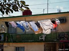 Au gré du vent (Jean S..) Tags: clothes clothesline house chair sky towel outdoors green yellow