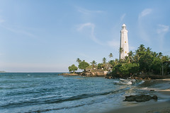 dondra lighthouse (blackeyeliner) Tags: lighthouse landscape beach sea boat tranquility architecture traveldestination travel tourism nature sand coconutpalmtrees coastline reef speedboat springtime nationallandmark cape tropical outdoors climate idyllic indianocean dondra southernprovince ceylon srilanka asia canoneos5d primelens canonef24mmf28
