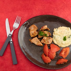 Marinated pork, potato puree and chopped tomatoers. (annick vanderschelden) Tags: cookingoil oil glass garlic sugar brownsugar fishsauce fish sauce cilantro soysauce salt chili lemonjuice juice redsurface ingredient food preparation raw porkmeat pork pepper belgium