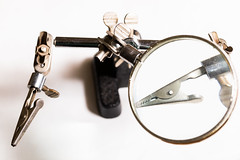 third-hand magnifier (jlodder) Tags: handtools flickrfriday thirdhandmagnifier magnifyingglass aligatorclip whitebackground highkey