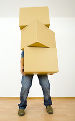Help... (cfdtfep) Tags: man oneperson person caucasian youngadult 1819years indoor realty realestate removal address box cardboard change flat house home property floor tired stand standing hold holding carry carrying bear room owner new movingin moving homeowner heavy weight hamal wood wholebody graybackground denim jeans poland