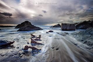 Remains Beneath the Sand (Explore)