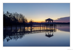 The Calm of Twilight (John Cothron) Tags: americansouth canoneos5dmkiv cothronphotography dawsonville dixie forsythcounty georgia johncothron lakelanier makroplanar502ze southatlanticstates southernregion thesouth us usa unitedstatesofamerica warhillpark zeissmakroplanart250mmze calm clearsky dawn job lake lakeshore landscape longexposure morninglight nature outdoor outside pier refectlion reflection reservoir scenic serene silhouette sky spring sunny sunrise tranquil twilight water img25217180401422018 ©johncothron2018 thecalmoftwilight