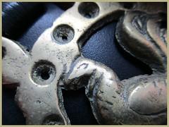 Horse Brass (JulieK (thanks for 6 million views)) Tags: hmm backintheday horsebrass canonixus170 macro metal leather texture craft skill
